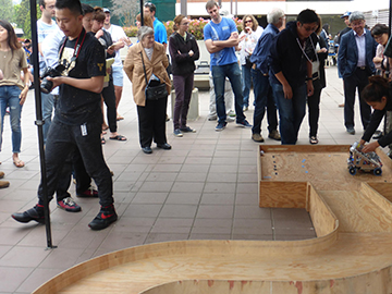 The wooden ramp has an overall length of about 180 inch.