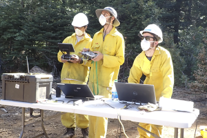 Schwarm (right) monitoring data collection alongside OptoKnowledge engineers.