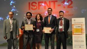 Jon Van Lew (second from right), a UCLA graduate student, split top prize of the inaugural FED Student Award @ISFNT.