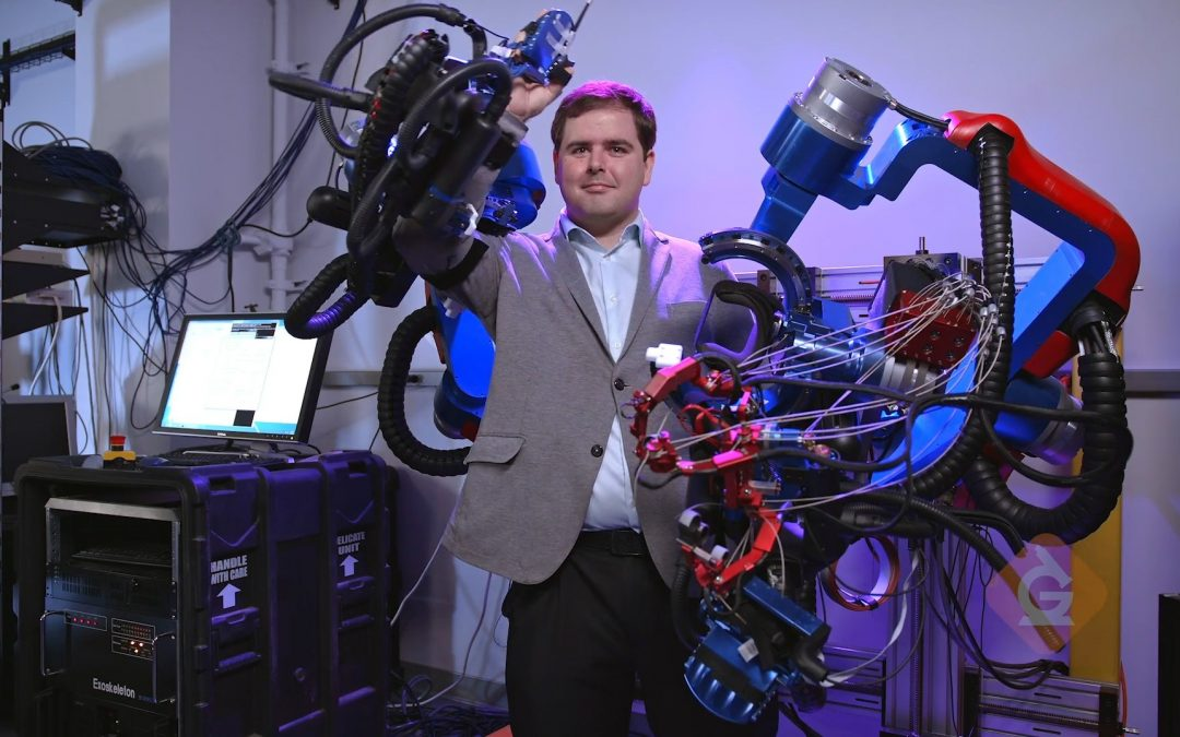 Peter Ferguson, a graduate student at the Bionics lab, demonstrates an exoskeleton system.